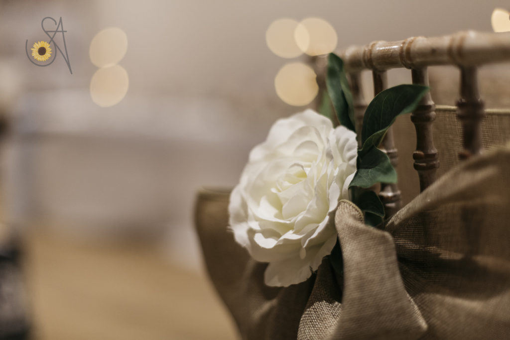 chair decoration hessian look linen sash embellished with roses and greenery | Fabulous Functions UK | Swindon | Wiltshire