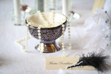 30s themed venue styling featuring pearls feathers, a monochrome, and an original artwork in the porcelain bowl by sculpture and ceramic artist Liz Watts MUA
