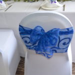 Organza sash tied in a sophisticated bow to adorn the back of your chair