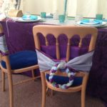 Peacock colours in your sashes to created a unusual chair decor.