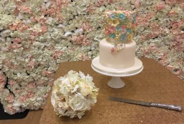 flower wall backdrop with cake table