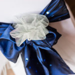 Chair decor of blue sequinned taffeta and tulle adornment