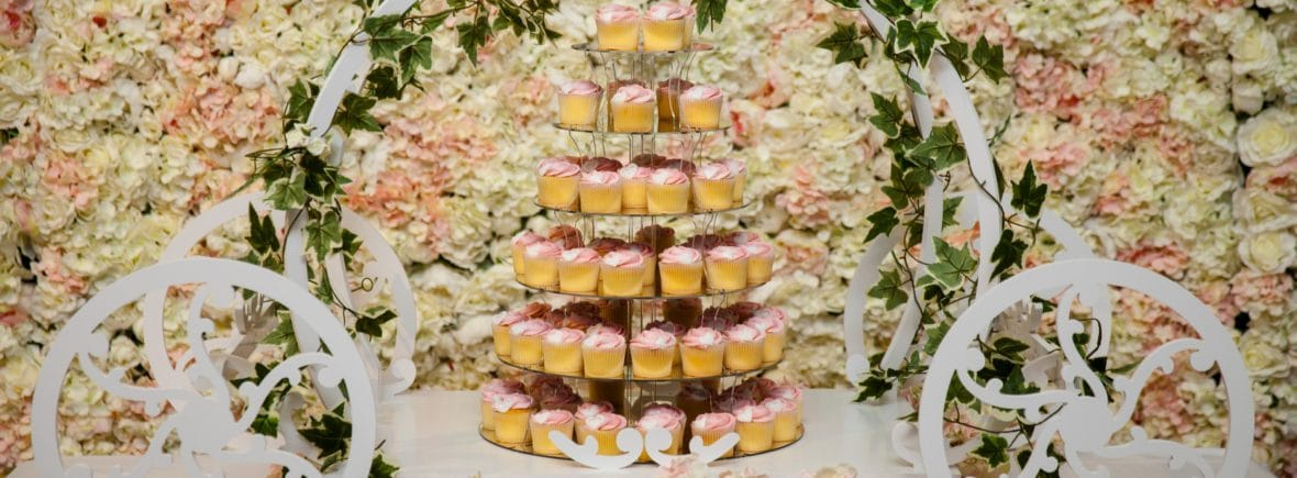 Flower wall and Cinderella Carriage Cake Display