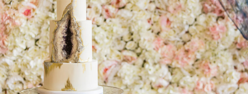Goede Cake with Silk Flower Wall Backdrop
