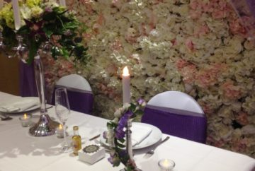 Silver toned candle sticks with entwined flowers -  Silk Flower Wall Hire