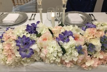 Silk flowers top table garland