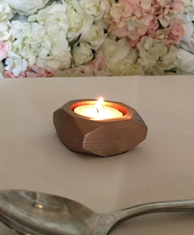 copper coloured nut shaped tea light holder