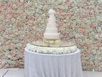 Floating flower wedding cake table with sequinned table linen