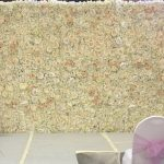 Floralie- Cream toned silk flower wall all setup for a catwalk show at Chelsea Old Town Hall