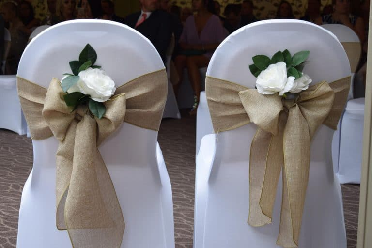 Linen Hessian sash with floral decor, a lovely addition for a rustic wedding and perfect with the hessian sashes