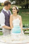 Bride and Groom with wedding cake on a floating cake table-Fabulous Functions UK