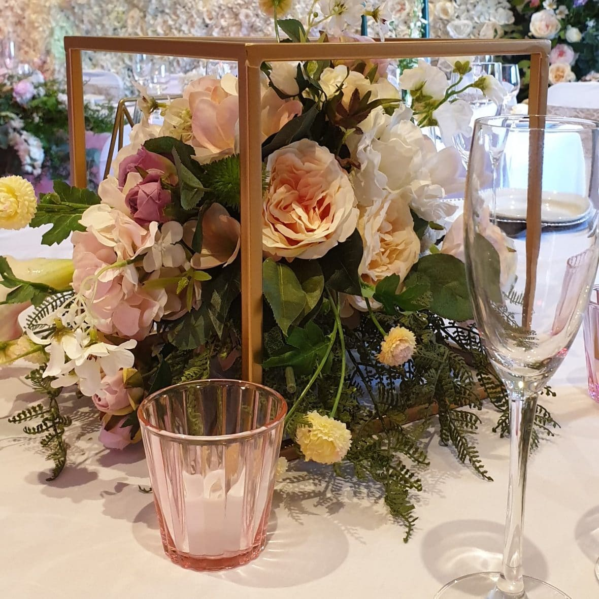 Gold toned cube frame for floral display