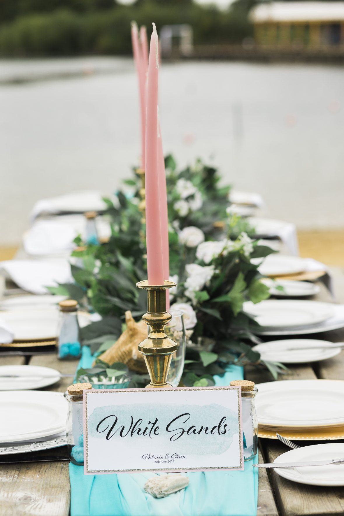 Pink tapered candles and brass candelsticks