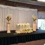 Fabulous Functions UK created a gorgeous wedding staging created at the Steam Museum in Swindon. The staging included a sweetheart table for two.