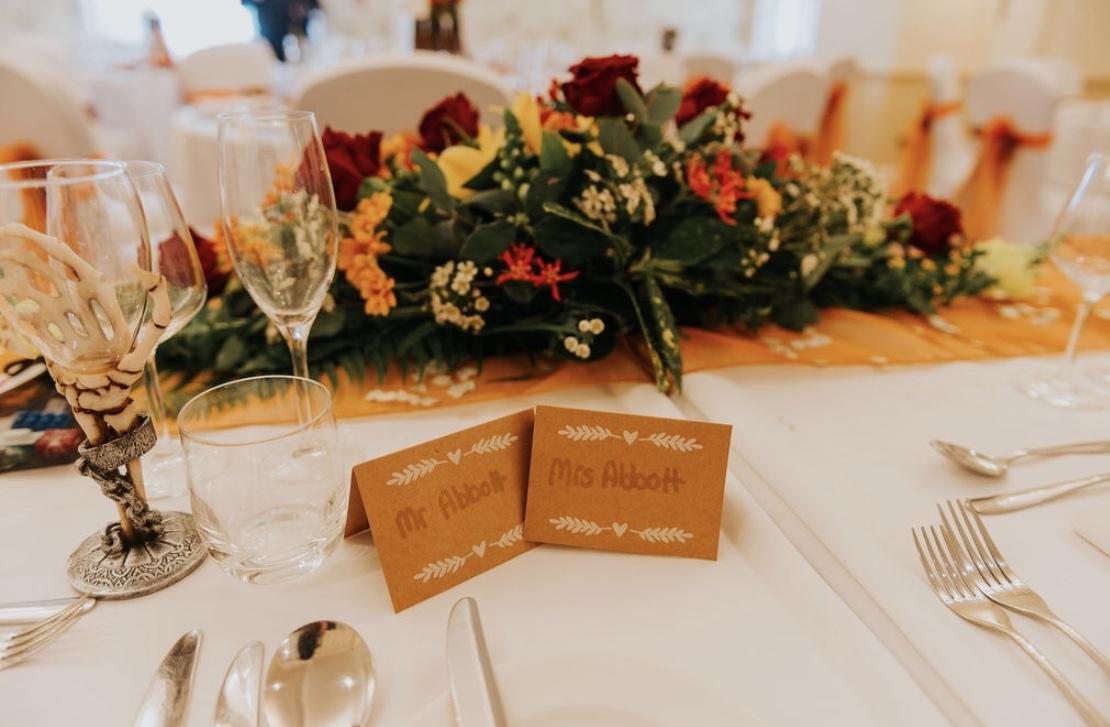 Top table decor complements the autumn themed venue decor