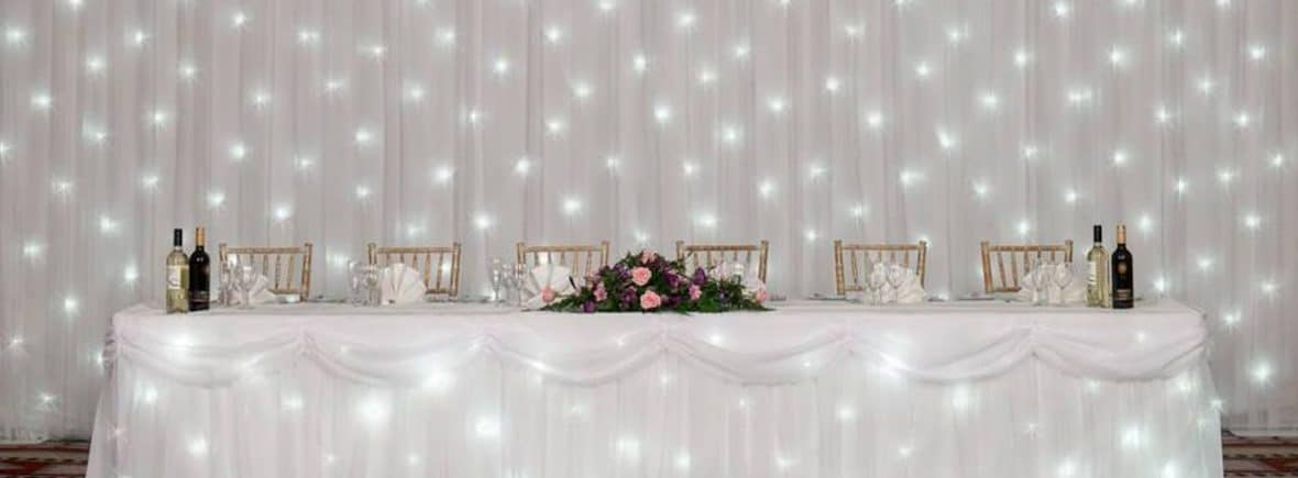 We often get enquires dropping into our inbox asking us what backdrops we can offer as part of our hire service. The short answer to that is: a wide range. But that's not too helpful is it? So, in this blog we'll give you an overview of the Fabulous Functions backdrop range - starlight backdrop