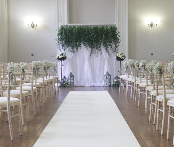 Floral curtains: gorgeous pleated white curtains topped with a pelmet of greenery or blossoms.