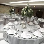 White charger plates with a diamante rim available from venue stylist and accessory hire Fabulous Functions UK