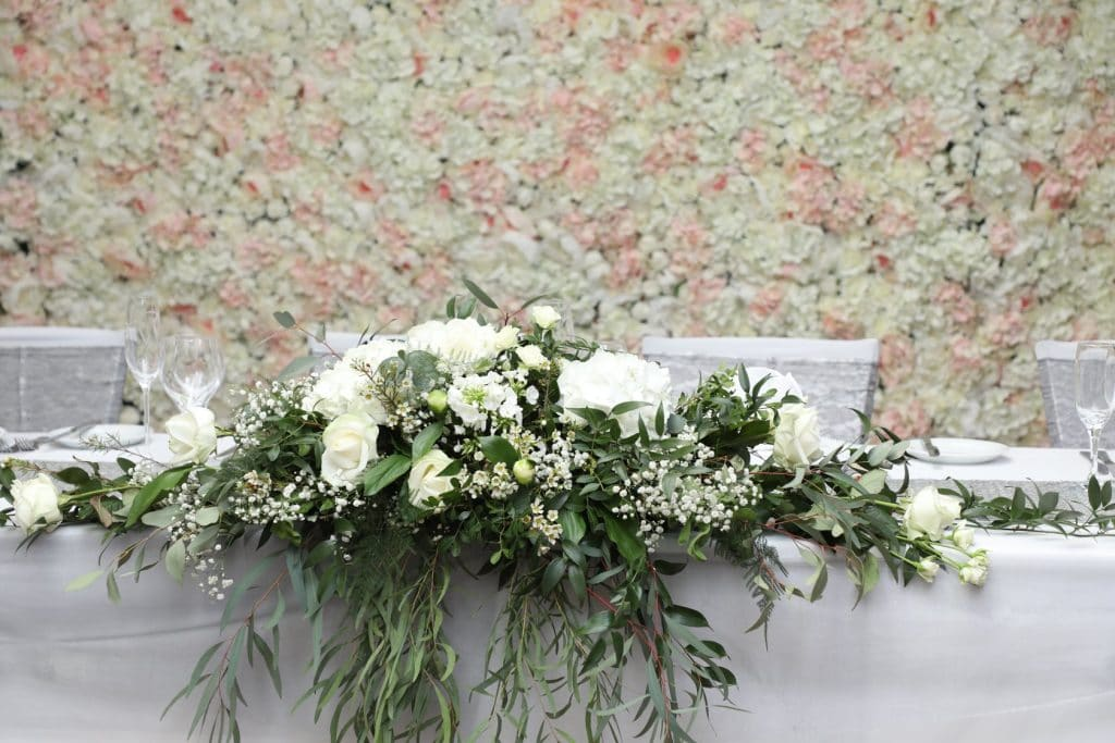 A Silver and Grey Wedding Theme - the flower wall behind the top table
