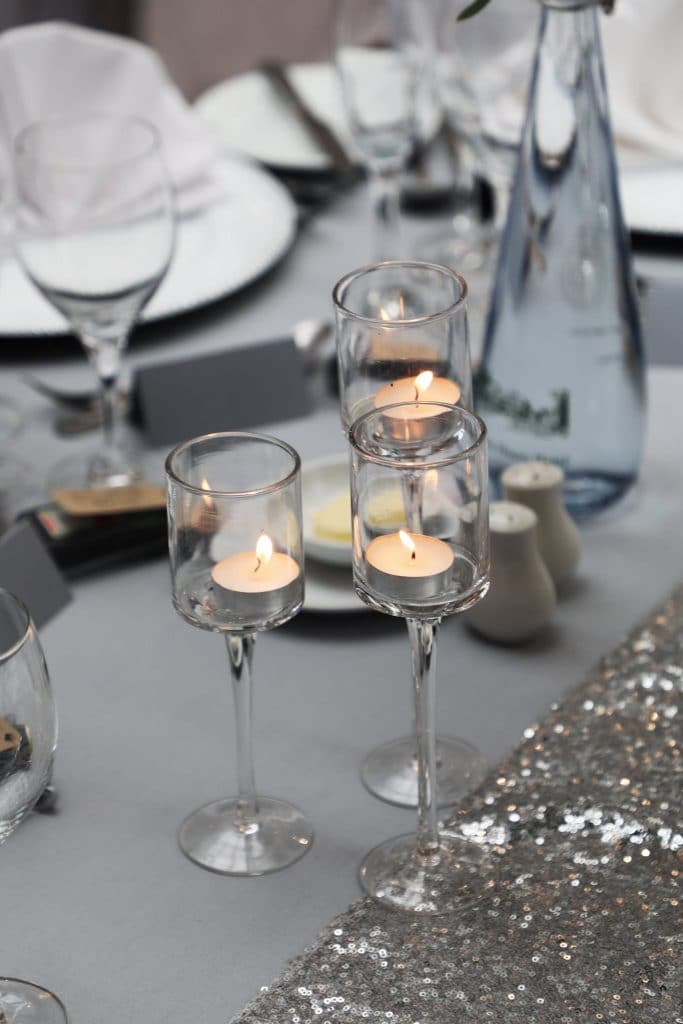 Staggered height glass tea light holders created warmth and brings a soft ambience to the decor