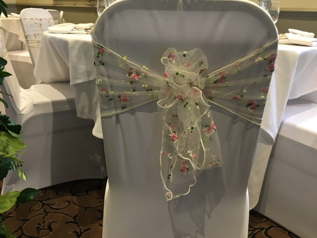 Organza sashes embroidered withs cherry blossoms - Available for hire from Fabulous Functions UK