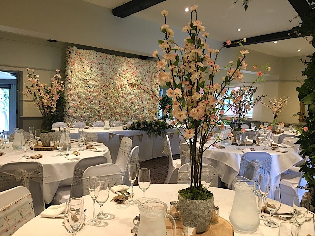 Centerpieces created with cherry blossoms - Venue styling was created by Fabulous Functions UK