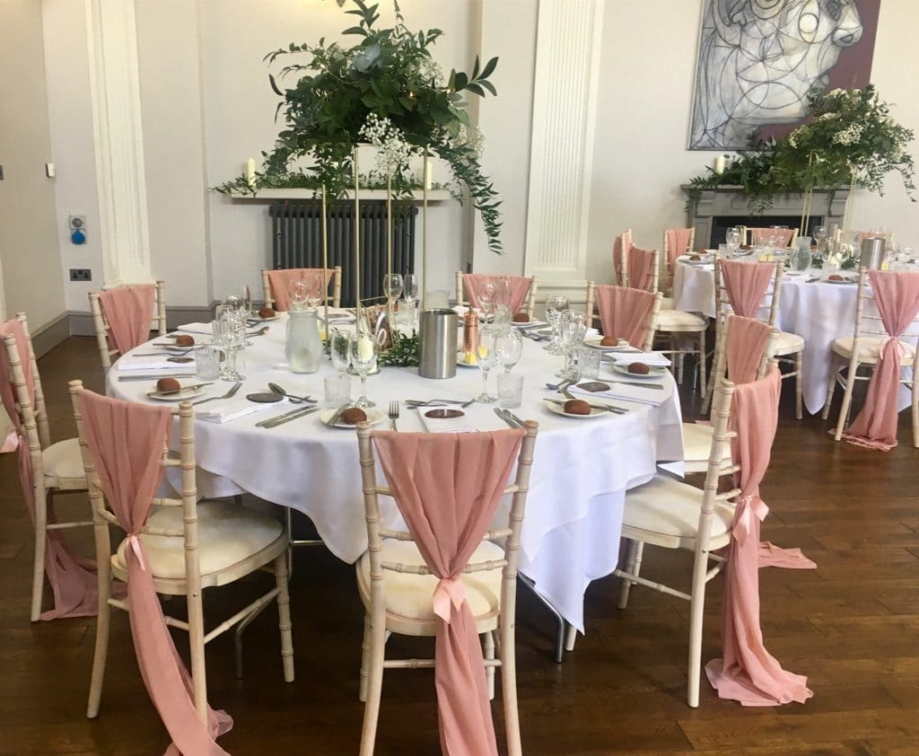 Decorate your wedding chairs with lengths of chiffon and  secure them with sating ribbons- Fabulous Functions UK