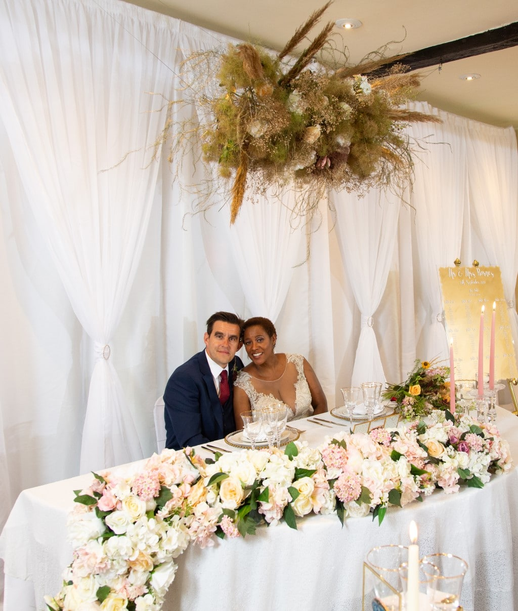 Sweetheart table with cascading floral garland