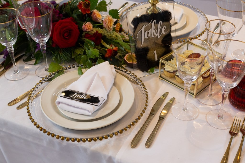An Ombre-themed Wedding with gold edged glass charger platesPhotoshoot - table place setting