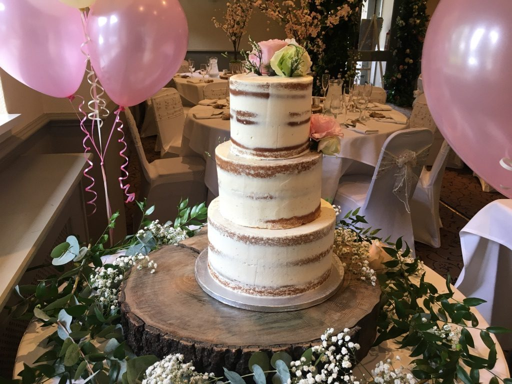 This gorgeous naked cake was displayed on a fabulous wood slice and surrounded by gypsophila and foliage