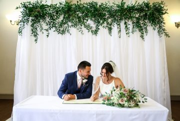 Draped voile backdrop with greenery Ceremony Backdrop -Fabulous Functions UK