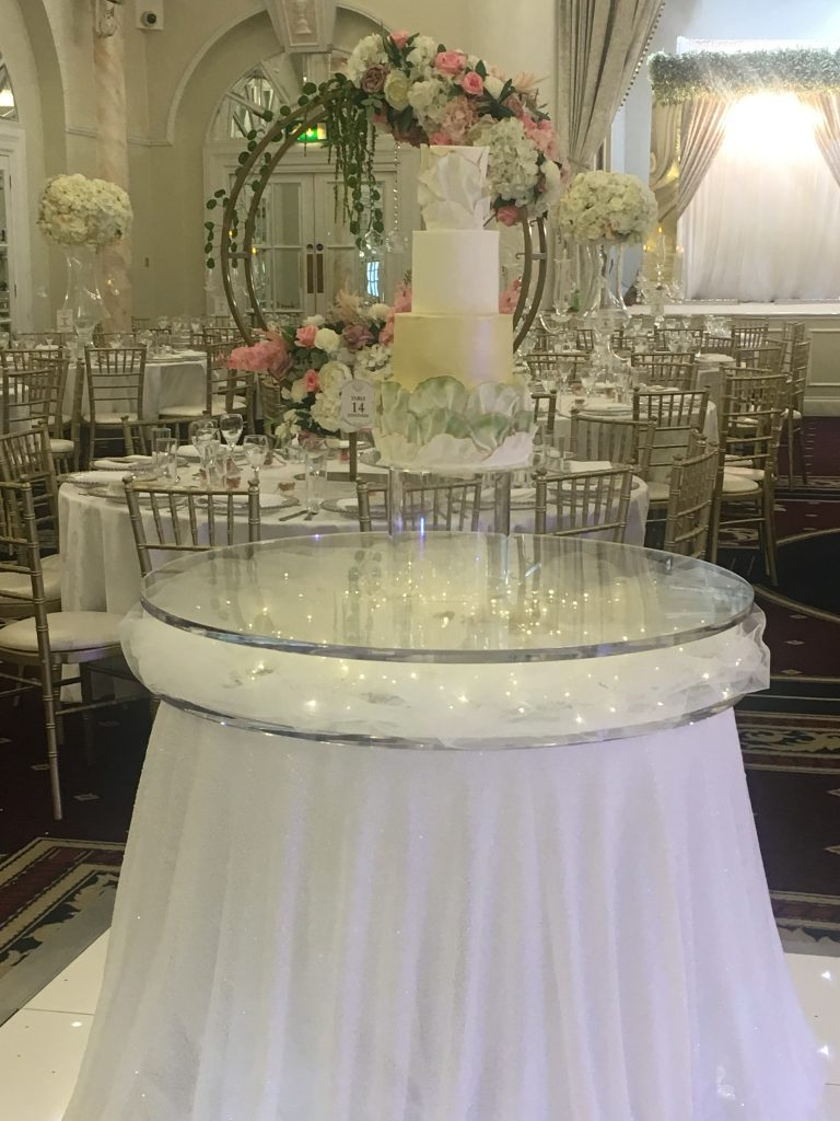Floating cake stand was used to display this beautiful wedding cake at the Decorium London - Fabulous Functions UK