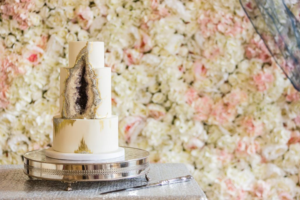 Goede Cake with a hint of Classic  Blue and a Silk Flower Wall backdrop from Fabulous Functions UK