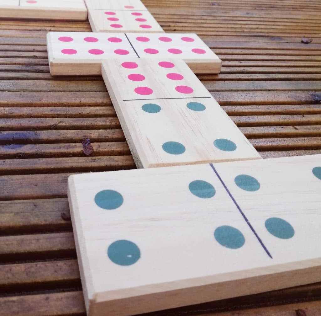 Giant dominoes on wooden decking - giant garden games for hire