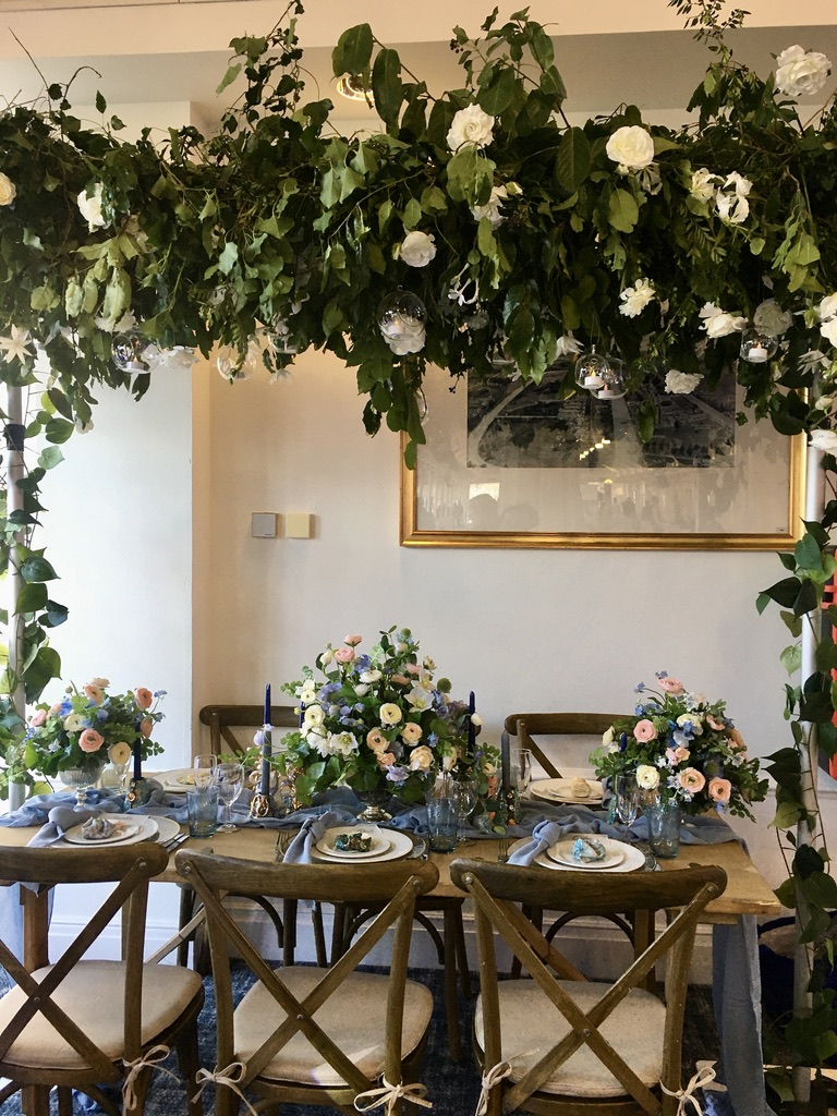 Floral canopy of foliage and florals to create a bespoke statement decor for your venue styling -Fabulous Functions UK
