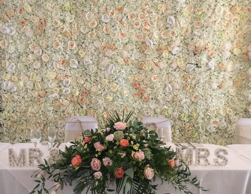 Floralie, a peaches and cream silk flower wall is part of the Reach for the Stars Venue Styling Package. Available from Fabulous Functions UK. It is a gorgeous backdrop for your family and friends photographs, or background to a special ceremony