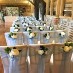 A blue themed wedding decor for Leanne and Chris chose a baby blue organza sash to dress their chairs and each bow was adorned with a small posy in white and blue florals and foliage. The blue theme was continued in the centrepieces designs created by the team at Fabulous Functions UK.
