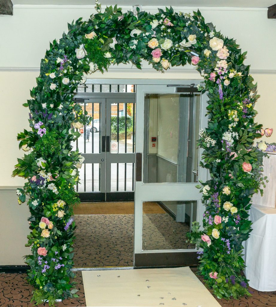 Floral entrance arch for a glorious entrance to your  wedding venue available from Fabulous Function UK