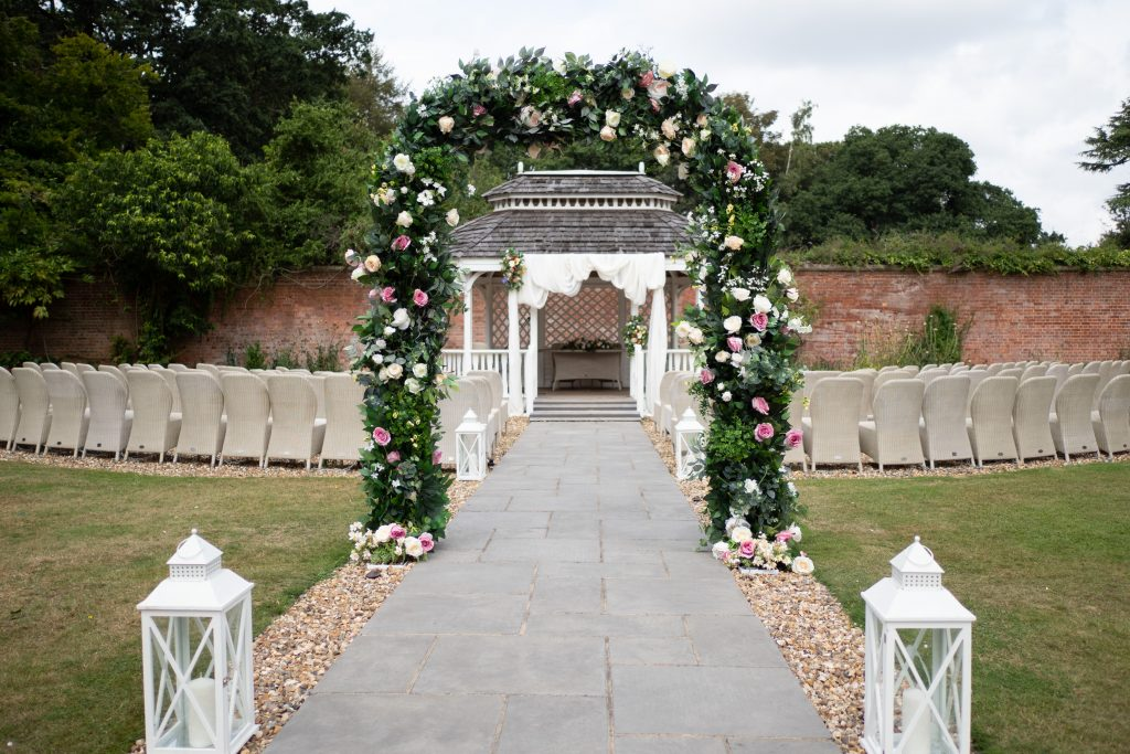 Wedding Floral Arch setup for Ceremony Decor - Accessory hire available from Fabulous Functions UK