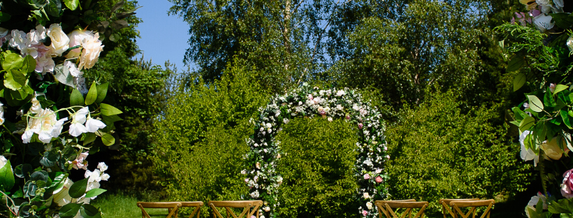 Creating a fabulous setting for an intimate wedding setting. Cross back chairs and a gorgeous floral arch makes the setting perfect for an intimate outdoor ceremony - Fabulous Functions UK created this gorgeous setting.