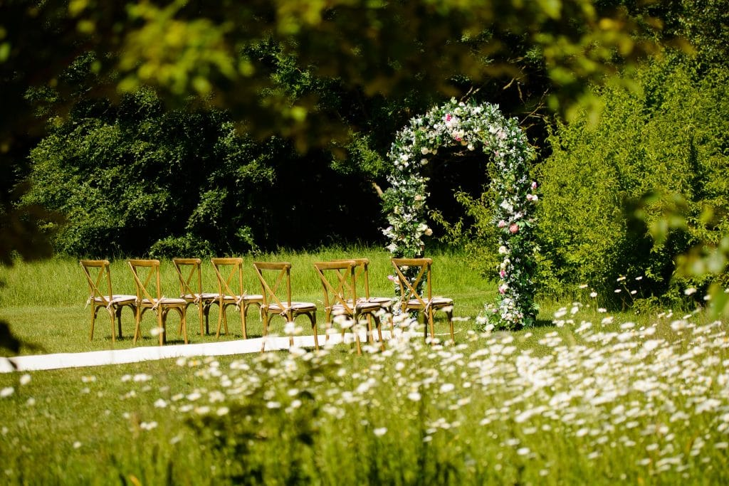Create a gorgeous space for your wedding ceremony with this  lush floral arch backdrop created by Fabulous Functions UK