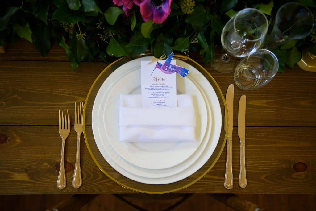 Table setting with hummingbird and lotus themed stationery for a multicultural wedding- Fabulous Functions UK