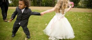 Keeping Junior Wedding Guests Happy - a small boy and girl at a wedding