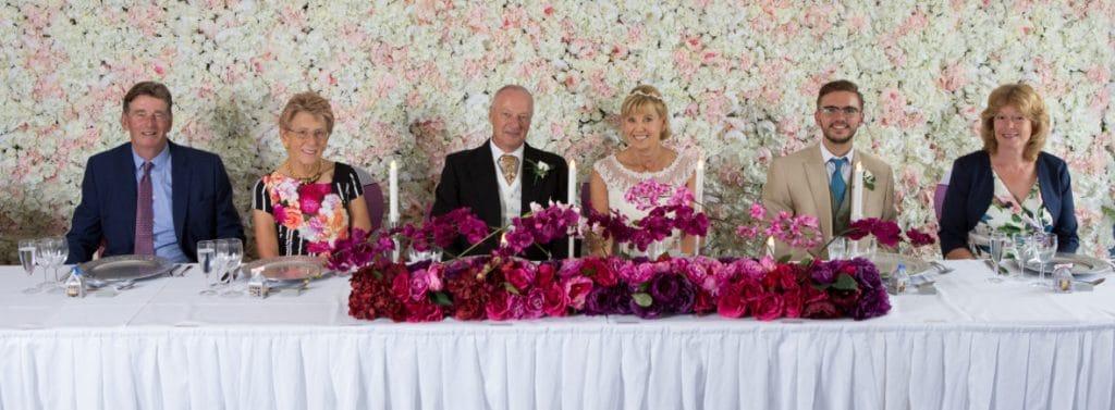 Silk Flower Wall - flower wall at a wedding at Wrag Barn golf club