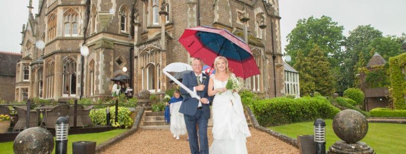 wedding party under umbrellas - 6 Wet Weather Wedding Planning Tips