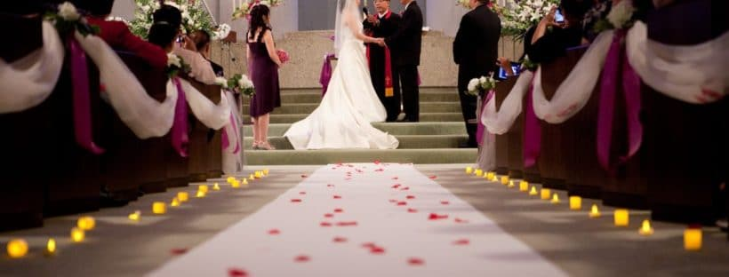 Is Giving Away the Bride Still Relevant? - bride and groom at alter
