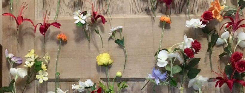 Are Budget Wedding Backdrops Cost Effective? - Flowers on wire forming a curtain.